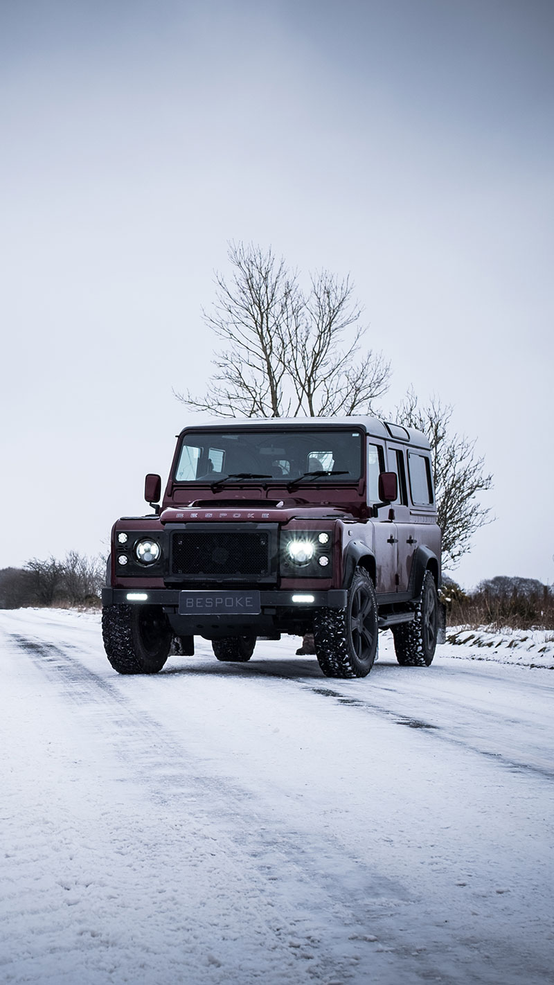 defender D110 SW sat on snowy county road