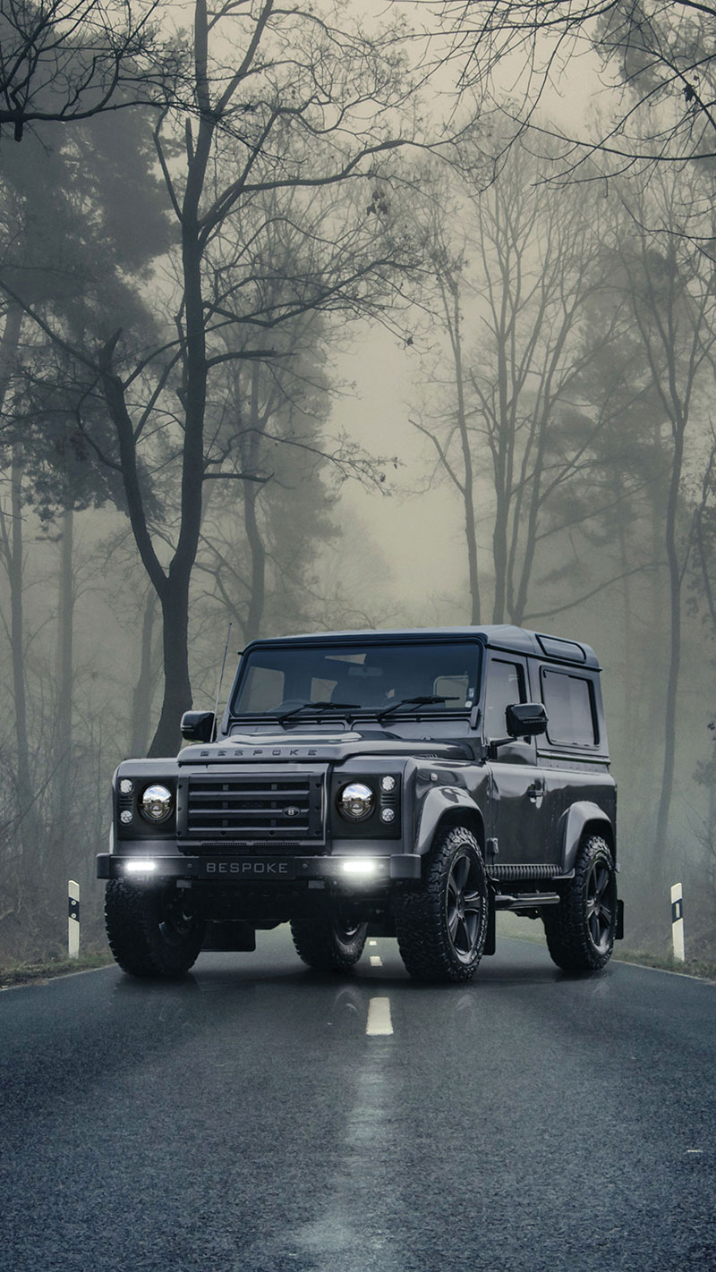 Black defender D90 on a misty road