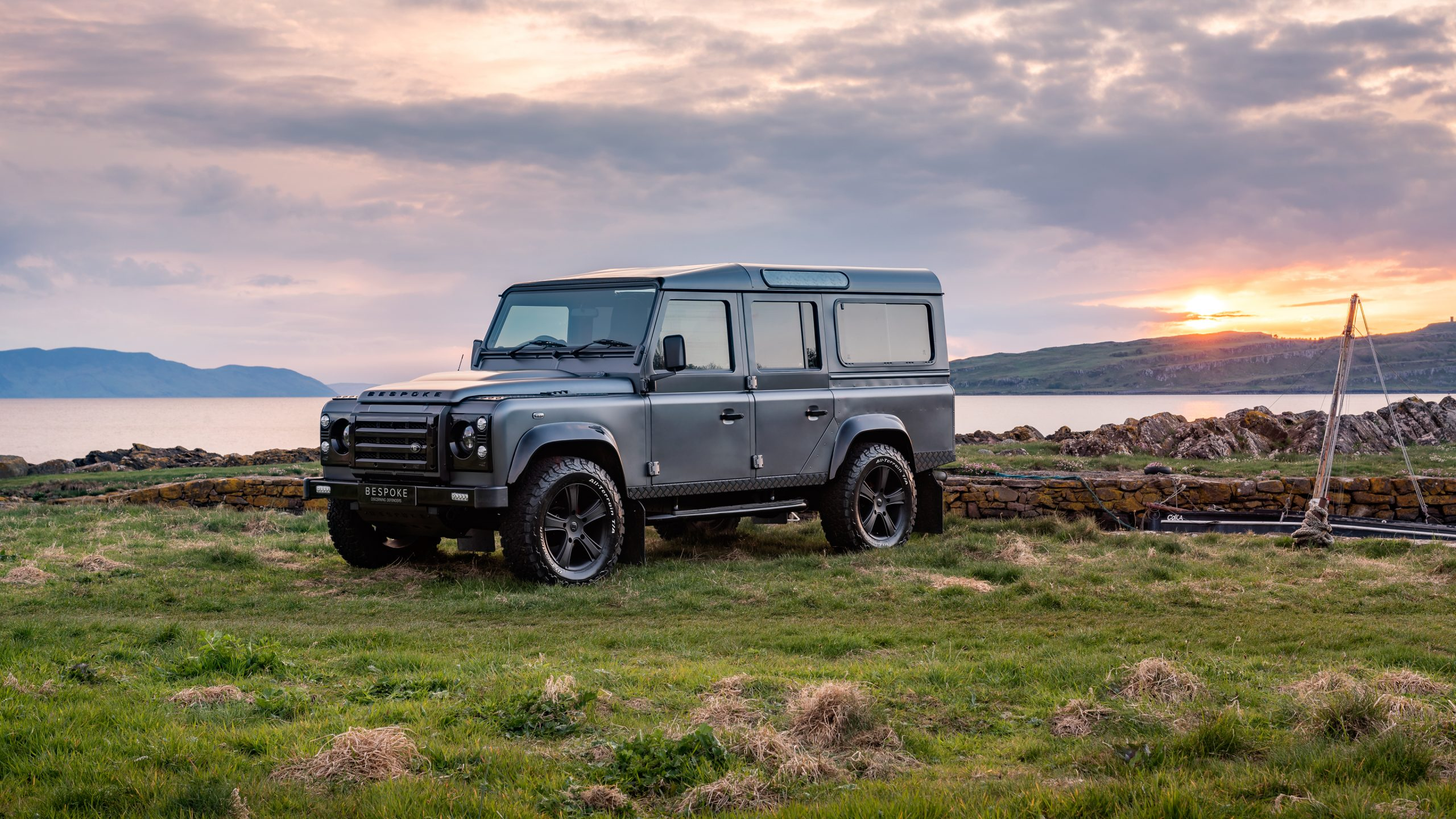 Bespoke defender 110 by the lake at sunset